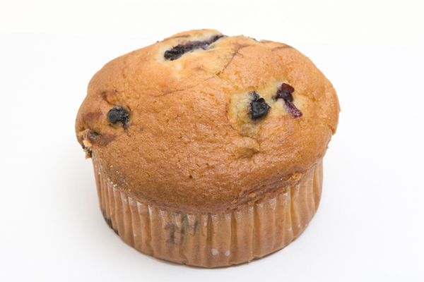 Golden brown cranberry and blueberry muffin